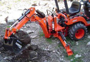 kubota excavator digging BX1500 Woods BH6000